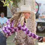 A rodeo queen hands out appetizers to the crowd at the 2014 Klickitat County Fair.