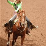 A rodeo queen rides by on her horse and waves to the crowd at the 2014 Klickitat County Fair Rodeo.