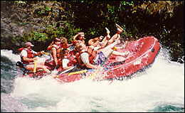 A group of people white water rafting.