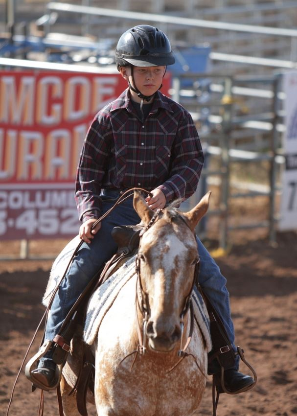 A boy rides his horse in the arena at the 2014 Klickitat County Fair.