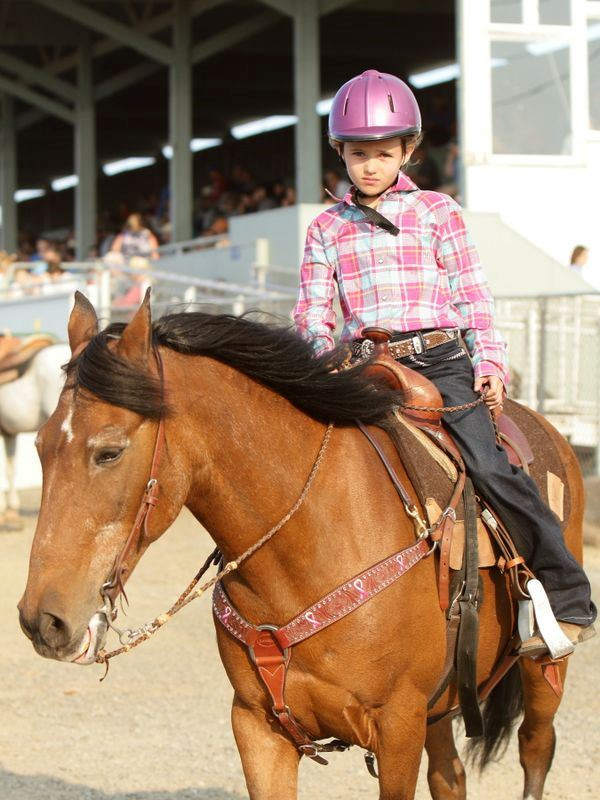 A young girl sits atop her horse at the 2015 Klickitat County Fair.