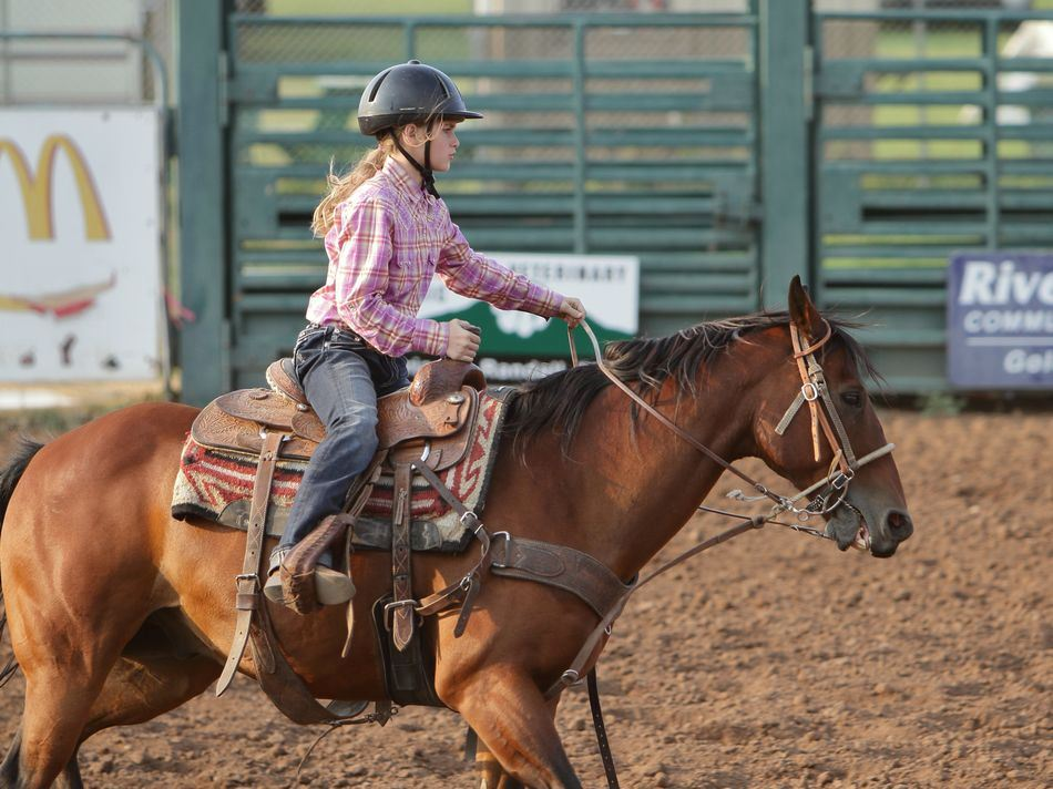 A girl performs on her horse at the 2015 Klickitat County Fair.