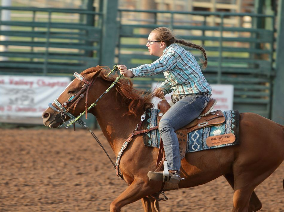 A girl runs her horse at the 2015 Klickitat County Fair.