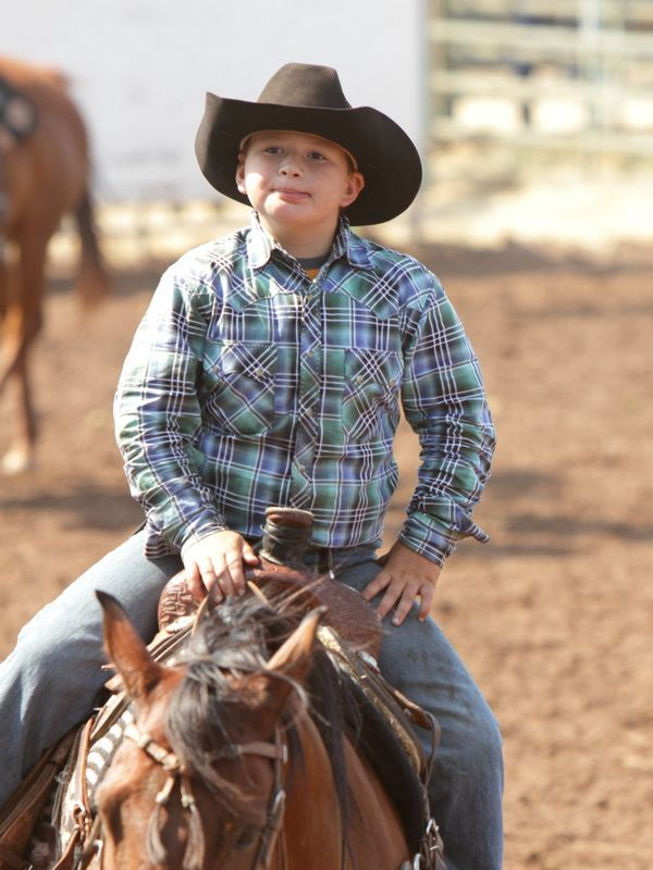A young man sits atop his horse at the 2015 Klickitat County Fair.